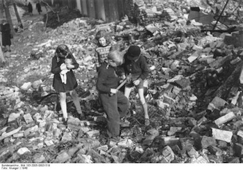Berlin children in rubble.