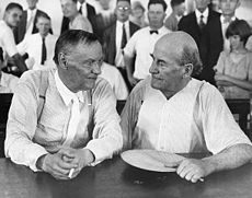 Clarence Darrow (left) and William Jennings Bryan chat in court during the Scopes Trial.