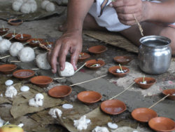 Small rice balls known as pindas are part of Hindu funeral ceremonies
