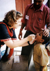A young boy receiving oral polio vaccine in India