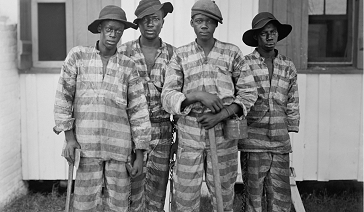 Four men in a convict leasing chain in 1915