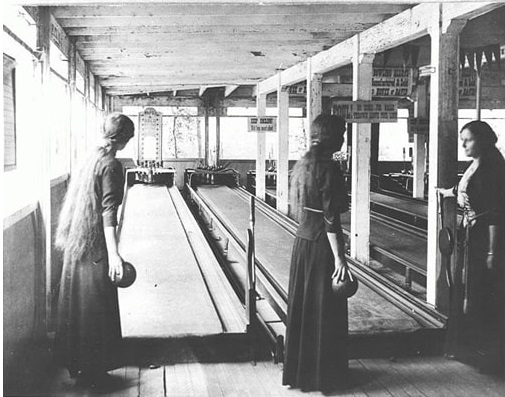 Women bowling in dresses 1915