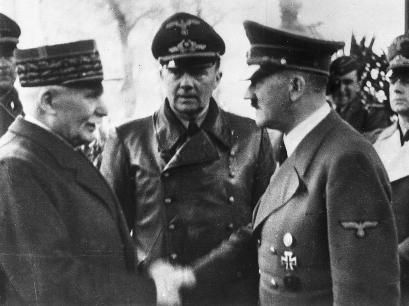 Hitler shaking hands with French leader Marhal Philippe Pétain in 1940