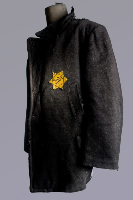 Coat with a Star of David patch on display at the Auschwitz Museum