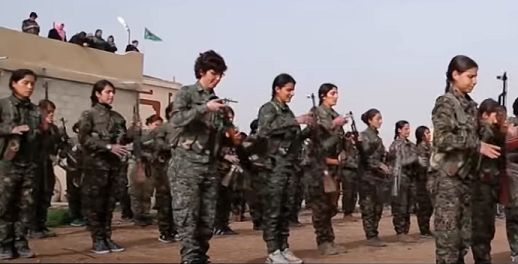 Peshmerga fighters standing in formation