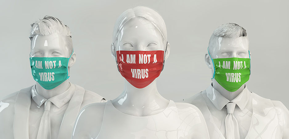 Mannequins wearing masks that say I Am Not a Virus