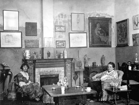 Gertrude Stein and Alice B Toklas seated in their living room at 92 rue de Fleurus
